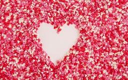 O coração feito do colorido polvilha Imagem de Stock