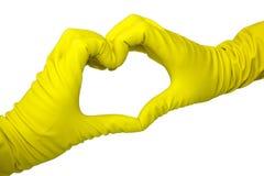 O coração fez por duas mãos em luvas do látex no branco foto de stock royalty free