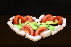 O coração salgado cru deu forma à gordura da carne de porco com vegetais Imagens de Stock Royalty Free