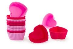 O coração vermelho e cor-de-rosa deu forma a caixas do bolo do silicone Foto de Stock