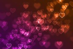 O coração colorido borrado assina fundo defocused Fotografia de Stock