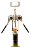 O corkscrew abre um frasco Fotografia de Stock Royalty Free