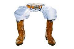 O cowboy dos carregadores das calças de brim senta-se sobre Fotografia de Stock Royalty Free