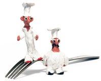 O cozinheiro chefe alegre fêz a argila do ââof Imagens de Stock Royalty Free