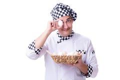 O cozinheiro chefe com uma cesta dos ovos fotografia de stock