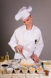 O cozinheiro chefe marc o pão do trigo Foto de Stock Royalty Free