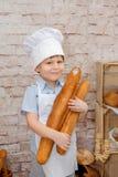 O cozinheiro chefe novo Fotografia de Stock