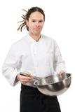 O cozinheiro chefe novo que mistura com whisk Imagens de Stock