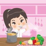 O cozinheiro chefe novo saboroso na cozinha ilustração royalty free