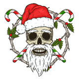 O crânio de Santa Claus no fundo dos ramos do omella e dos doces cruzados Crânio de Santa Claus Fotos de Stock Royalty Free