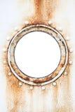 O círculo vazio oxidou vigia na parede do navio Fotos de Stock