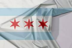 O crepe e o vinco da bandeira de Chicago da tela com espaço branco, a cidade de Chicago são a cidade a mais populoso em Illinois imagem de stock