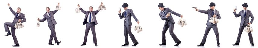 O criminoso do homem de negócios com os sacos de dinheiro fotografia de stock