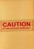 O CUIDADO é este pacote danificado? fotografia de stock