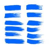 O curso da escova de pintura da tinta azul do vetor da cole??o ajustou cursos decorativos tirados m?o da escova do grunge a cole? foto de stock royalty free