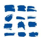 O curso da escova de pintura da tinta azul do vetor da cole??o ajustou cursos decorativos tirados m?o da escova do grunge a cole? foto de stock