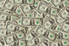 O dólar está sobrepondo o fundo Fotografia de Stock Royalty Free