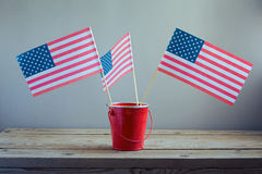 4o da celebração de julho com bandeiras dos EUA Imagem de Stock