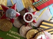 O ` da medalha para a defesa do ` de Stalingrad A ordem do ` vermelho da estrela do `, ` o grande ` patriótico da guerra, um sina imagens de stock royalty free