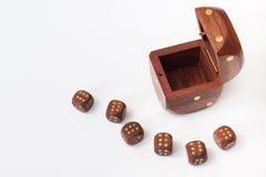 O dado de madeira aberto com um de madeira pequeno corta Imagem de Stock Royalty Free