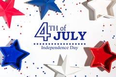 4o de decorações de julho em um fundo branco Fotos de Stock Royalty Free