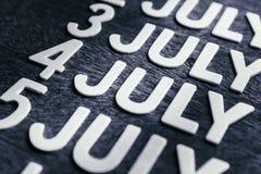 4o de letras da madeira de julho Foto de Stock