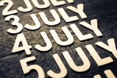 4o de letras da madeira de julho Fotografia de Stock Royalty Free