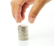O dedo põr a moeda Foto de Stock Royalty Free