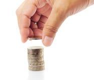 O dedo põr a moeda sobre a moeda Fotografia de Stock Royalty Free