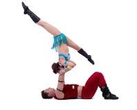 O desempenho de ano novo das acrobatas no estúdio Fotografia de Stock Royalty Free