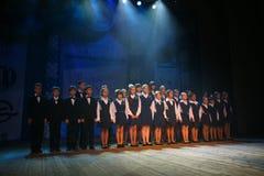 O desempenho do coro vocal no palácio da cultura Imagens de Stock Royalty Free