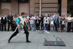 O desempenho dos solista-dançarinos do conjunto Imamat (Daguestão solar) com danças tradicionais do Cáucaso norte Imagem de Stock