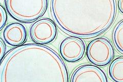 O desenho abstrato pintou os círculos de cores e de tamanhos diferentes e fotografados imagens de stock