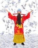 O deus de riquezas da parte da riqueza e a prosperidade com dinheiro chovem imagem de stock