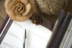 O dia na página do planejador aberta Imagens de Stock