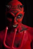 O diabo e o tridente. imagens de stock royalty free