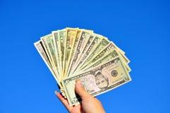 O dinheiro americano em uma mão Foto de Stock Royalty Free