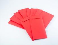 O dinheiro chinês do ano novo no vermelho envolve o presente no fundo branco Imagem de Stock Royalty Free