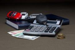 O dinheiro com calculadora e máquina Imagem de Stock Royalty Free