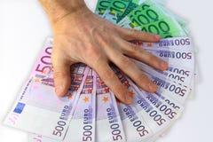 O dinheiro de papel de tampas da mão foto de stock