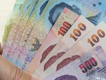 O dinheiro do baht tailandês, ganha e salvar o dinheiro Fotos de Stock Royalty Free