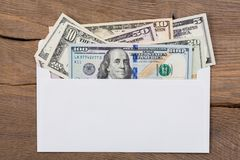 O dinheiro do dólar no branco envolve Fotos de Stock
