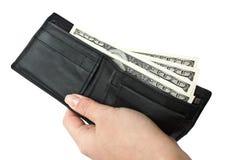 O dinheiro está em uma bolsa Fotografia de Stock Royalty Free