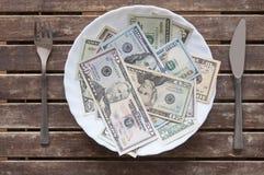 O dinheiro não pode ser comido Imagens de Stock Royalty Free