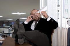 O diretor está trabalhando duramente Imagens de Stock