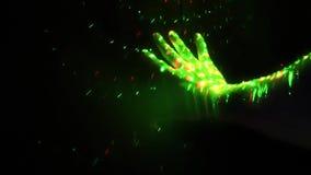 O disco do laser ilumina pontos coloridos