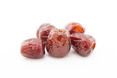 O doce secou o jujuba ou datas vermelhas no fundo branco Imagem de Stock