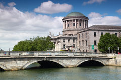 O'Donovan Rossa Bridge and Four Courts Stock Photography