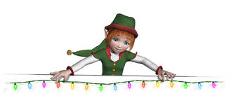O duende de Santa está pendurando luzes de Natal Imagens de Stock Royalty Free
