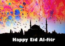 o EL feliz FITR da palavra EID escrito ao lado de uma mesquita Fotografia de Stock
